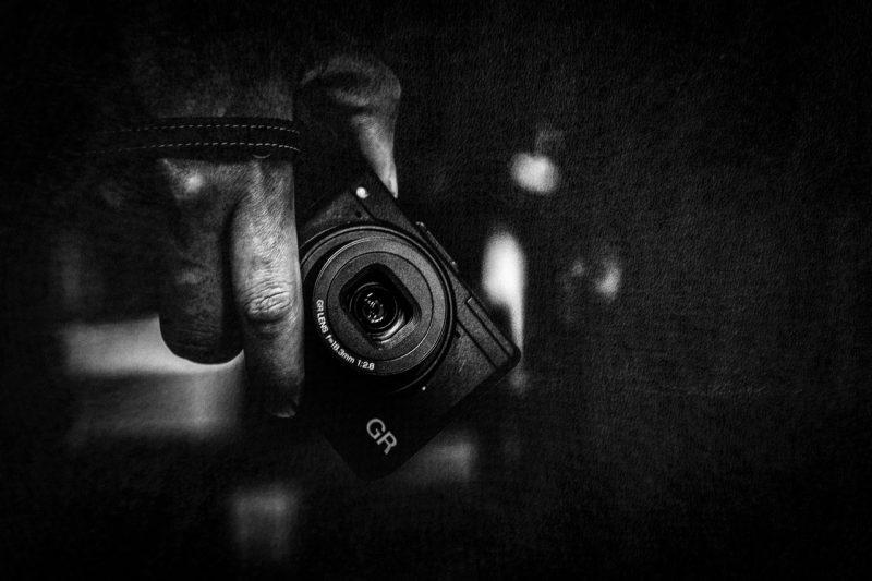 Ricoh GR holding camera